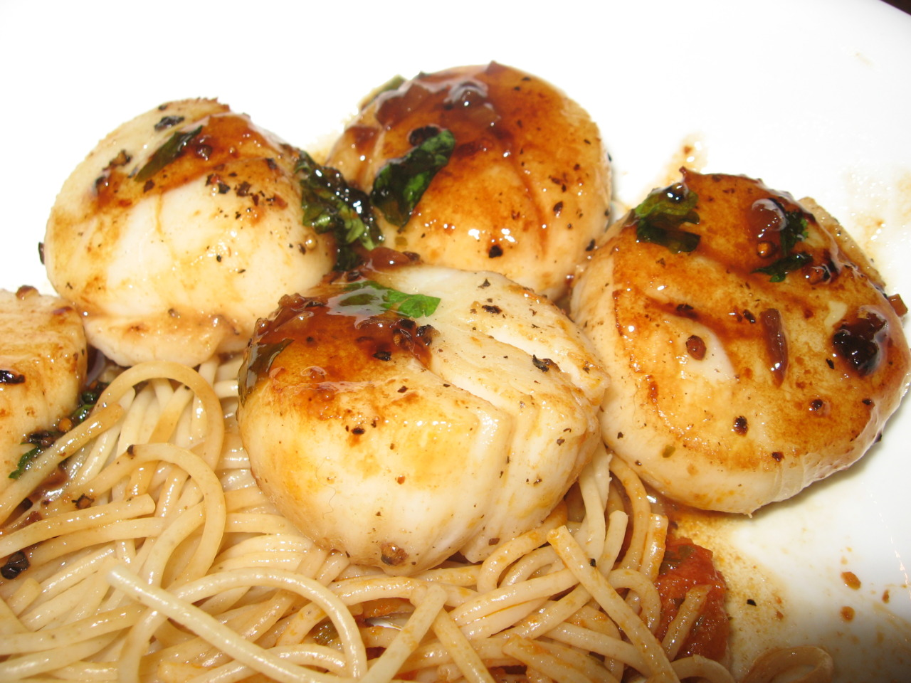 Pan Seared Scallops with a champagne reduction and pasta.