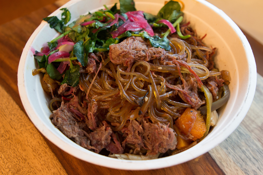 Red Angus Japchae - Korean stir fried noodles with shredded smoked chuck steak, onions, peppers and lime dressed watercress.