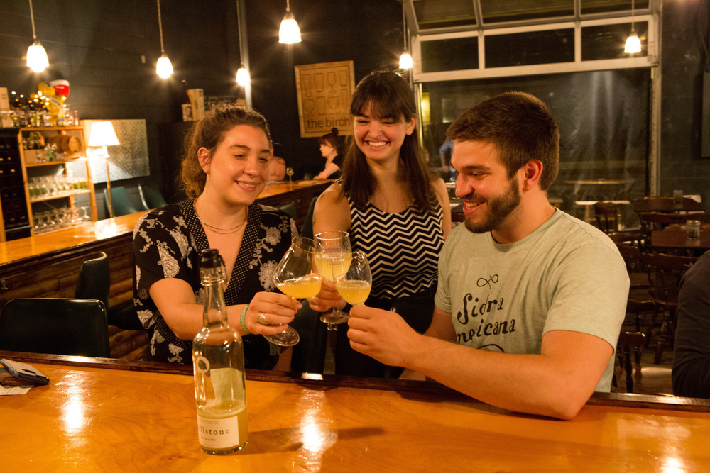 Malia Paasch, owner of The Birch is flanked by Sara and Kyle Sherrer of Millstone Cellars