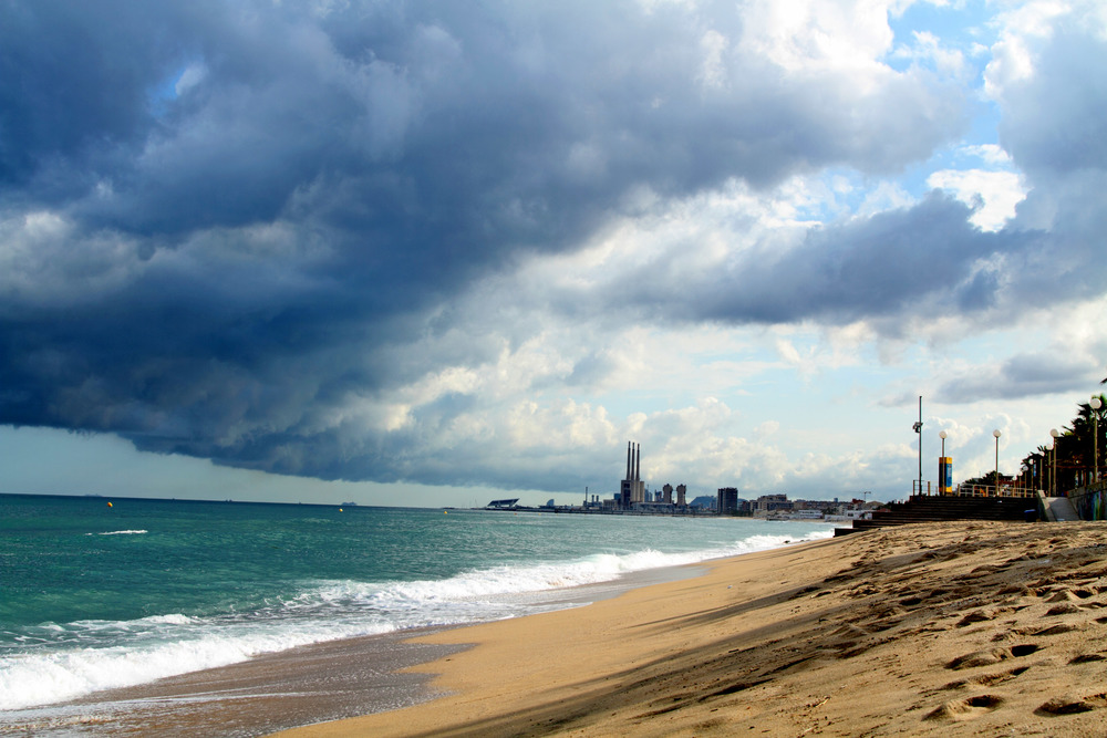 SPAIN_RAIN CLOUDS_SHORELINE OCEAN_CITY BACKGRouND_2.jpg