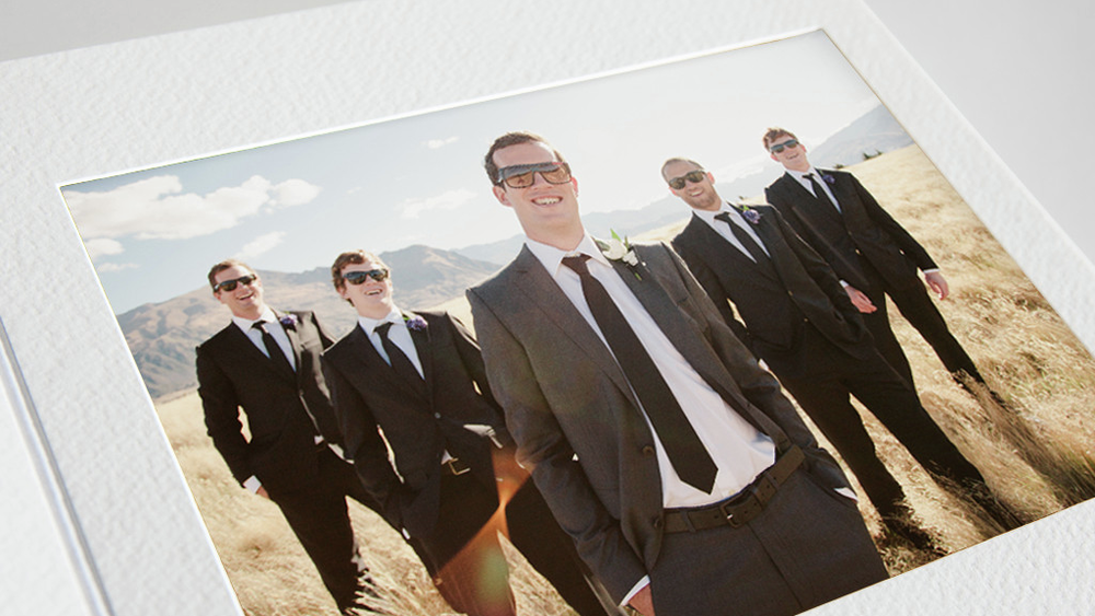 fine art wedding album groom and groomsmen in field mountains overlay matt