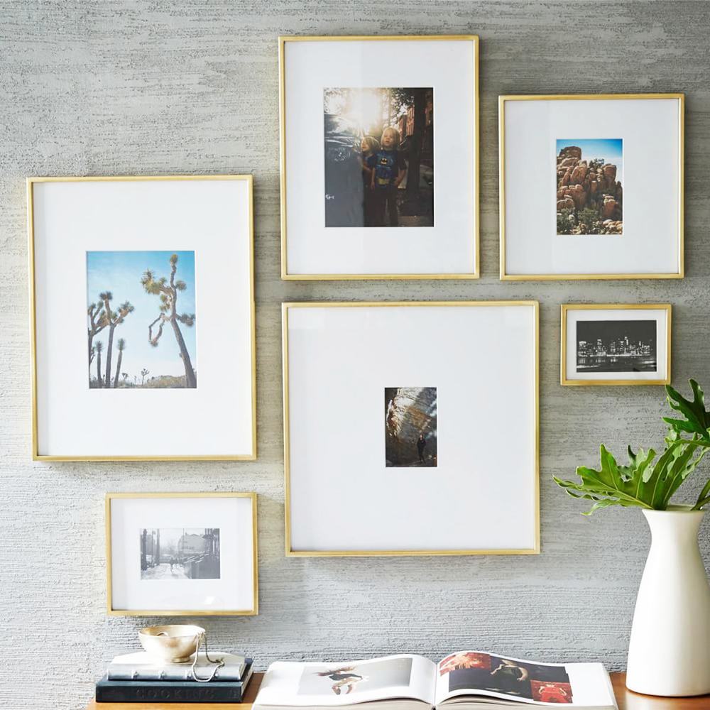 polished gold brass fine art frame collection collage on wall