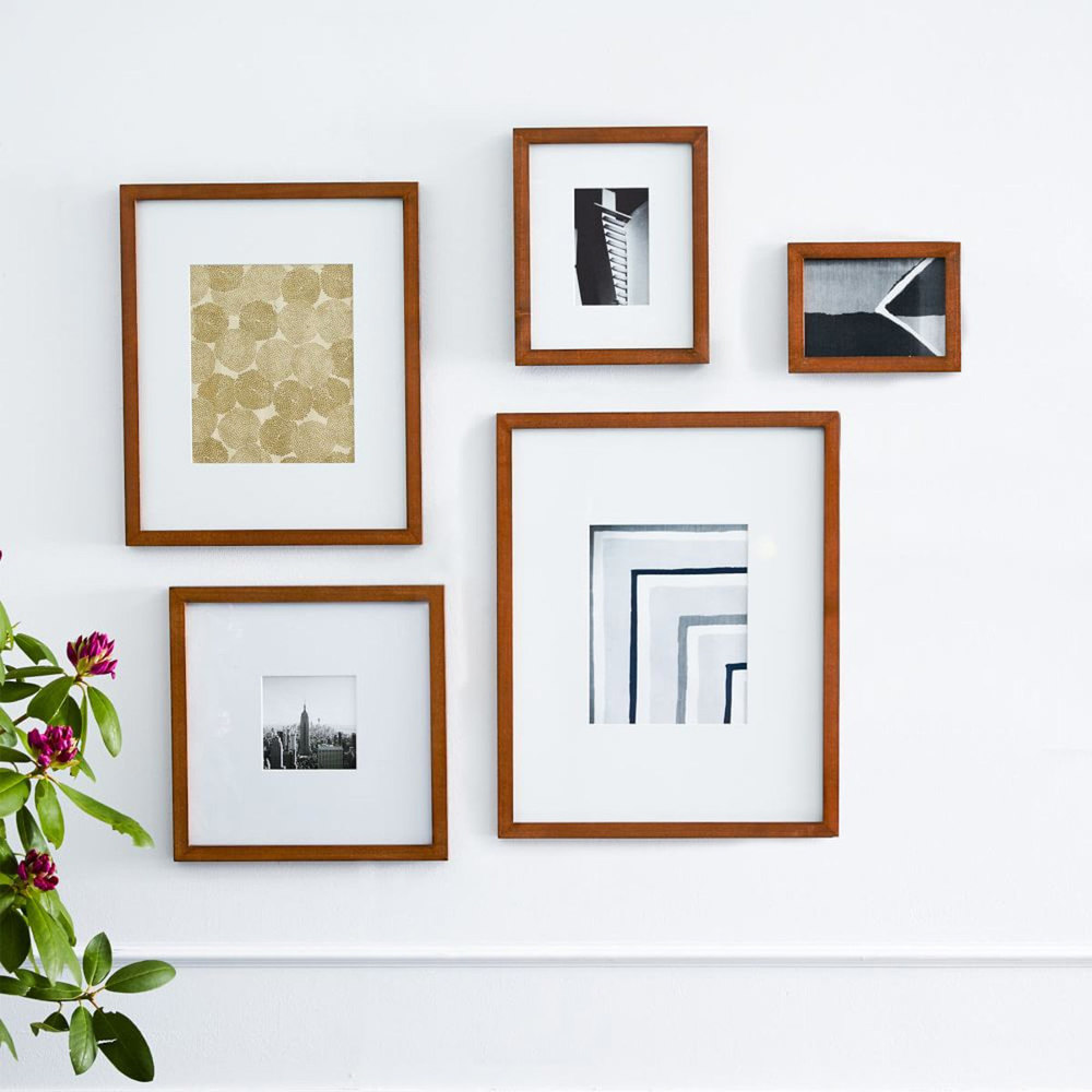 timber acorn fine art frame collection on white wall