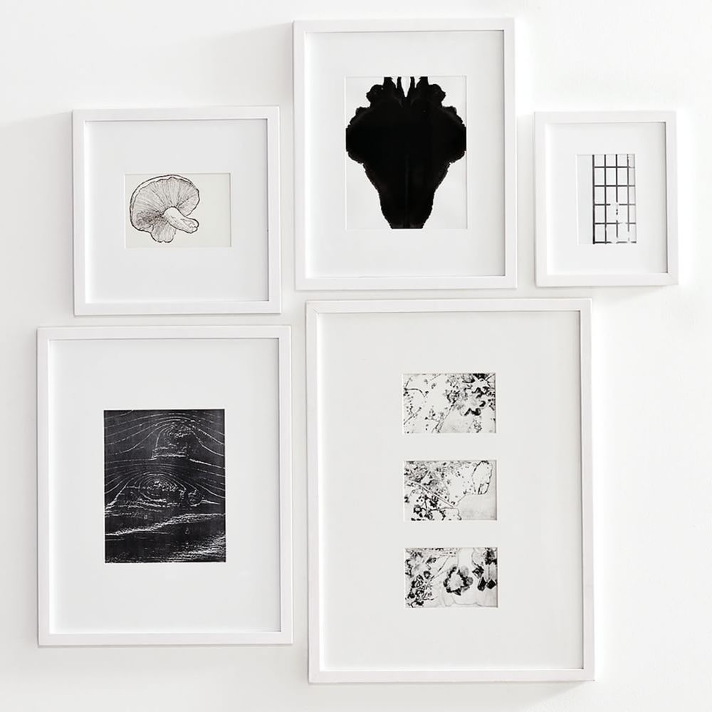white fine art frame collection arranged on white wall