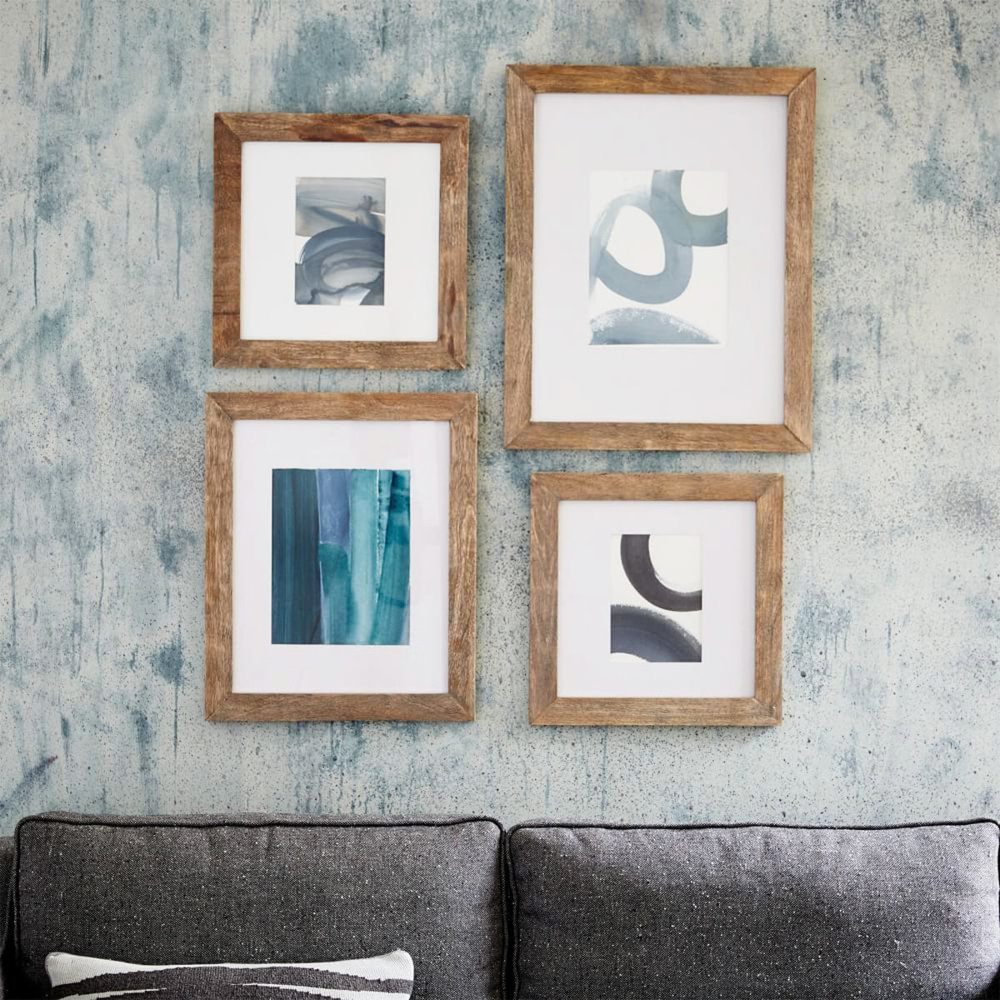 rustic wood fine art frame collection on wall above couch
