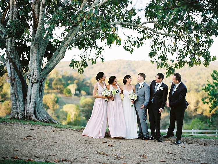 000011 Brisbane Fine Art Wedding Photograph of wedding bridal party outside under a tree laughing at sunset.jpg