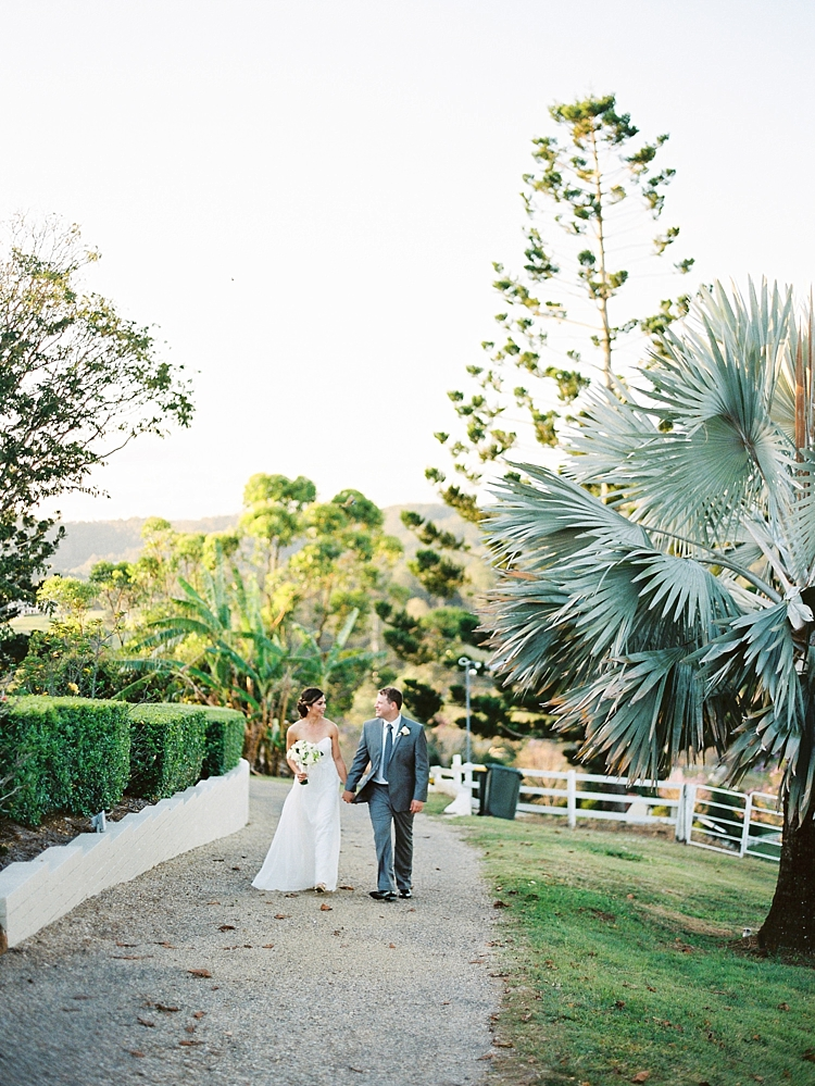 000012 Brisbane Fine Art Wedding Photograph of couple walking in garden holding hands.jpg