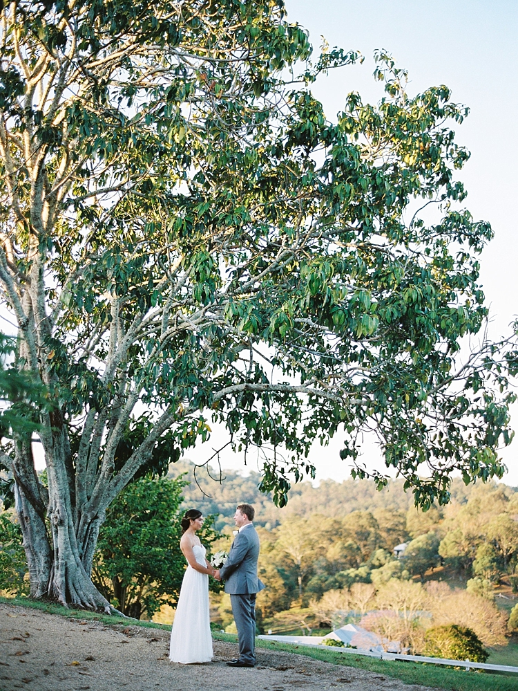 000014+Brisbane+Fine+Art+Wedding+Photograph+of+couple+holding+hands+under+large+tree+gazing+into+eachothers+eyes