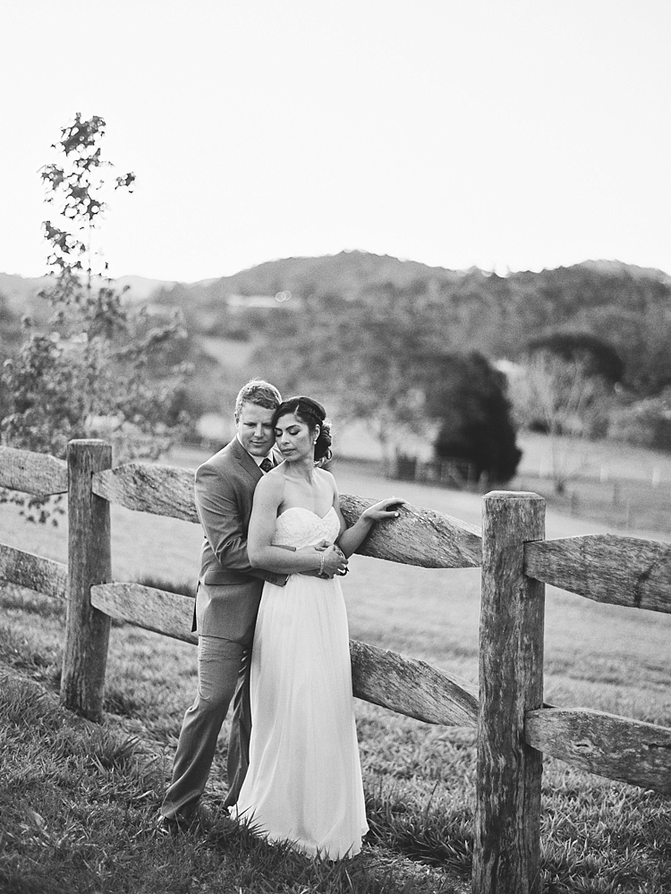 000022 Brisbane Fine Art Wedding Photograph of couple hugging in black and white in meadow.jpg