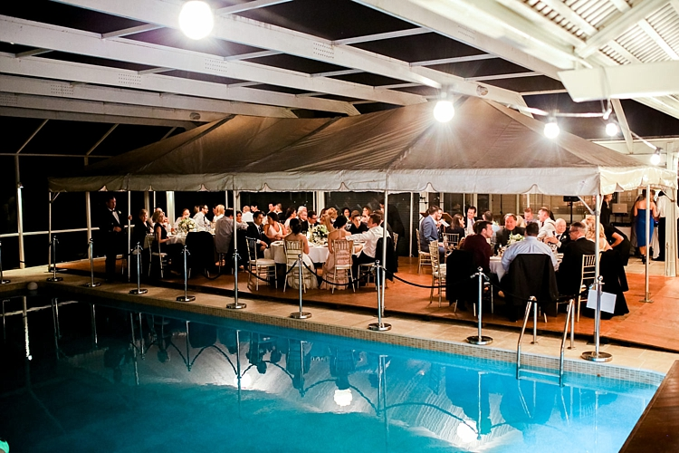 000023 Brisbane Fine Art Wedding Photograph of Reception area whilst guests are seated on private property next to pool.jpg