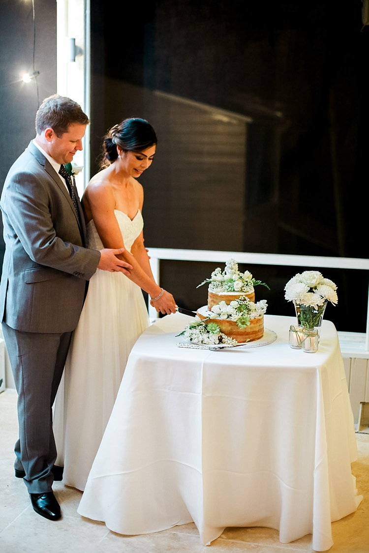 000024 Brisbane Fine Art Wedding Photograph of wedding couple cutting the wedding cake together.jpg