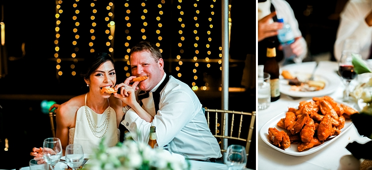 000029 Brisbane Fine Art Wedding Photograph of bride and groom eating chicken wings with platter next to it.jpg