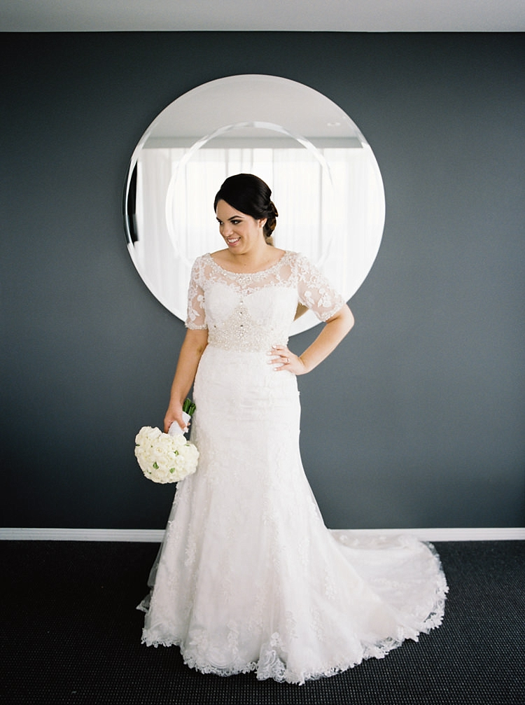 Brisbane Gold Coast Fine Art Film Photographer Love Couple Wedding Dress beautiful bride wedding dress flowers getting ready hair and makeup mirror wedding dress white beading stitching detail