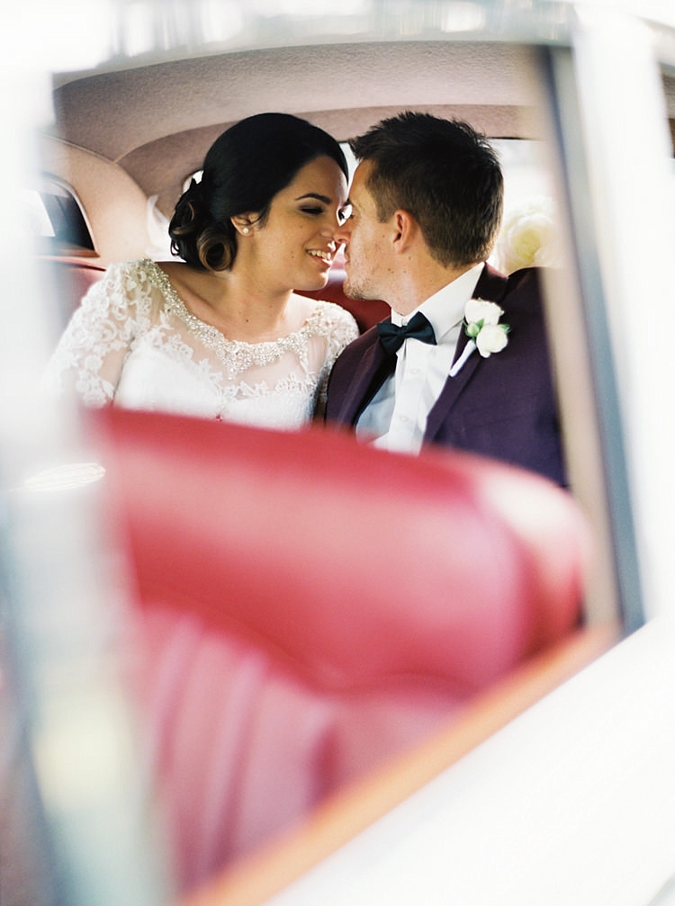 Brisbane Gold Coast Fine Art Film Wedding Photographer Contax 645 Love Couple Wedding Dress kissing backseat of car best day ever bride groom
