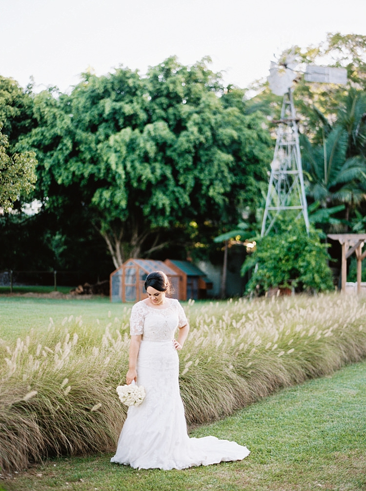 Brisbane Gold Coast Fine Art Film Wedding Photographer Contax 645 Love Couple Wedding Dress bride posing in field with windmill beautiful bouquet