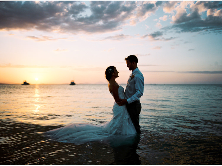 beach-sea-boats-bridal-portrait-bride-coastal-destination-dress-fine-art-wedding-photographer-great-barrier-reef-groom-sunset-sunshine-coast-noosa-walking-in-water-whitsundays.jpg