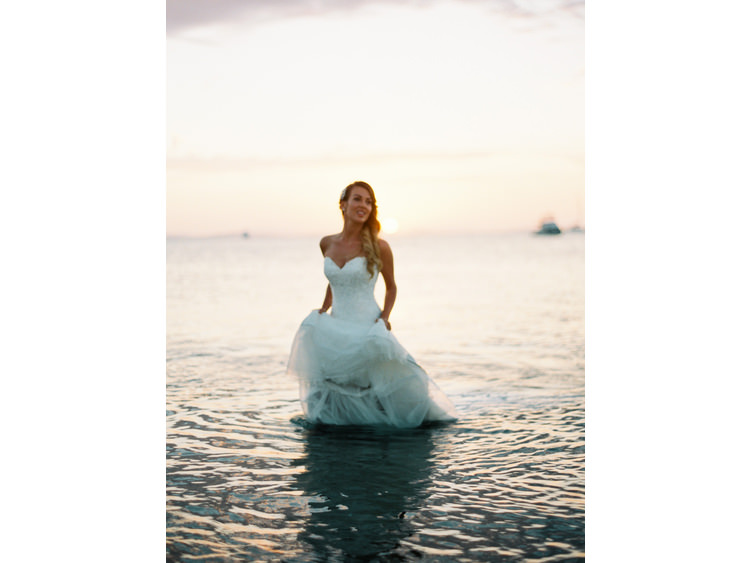 beach-sea-boats-bridal-portrait-bride-coastal-Couple-destination-dress-film-photography-fine-art-wedding-photographer-french-groom-kodak-portra-sunset-sunshine-coast-noosa-walking-in-water-water-whitsundays.jpg