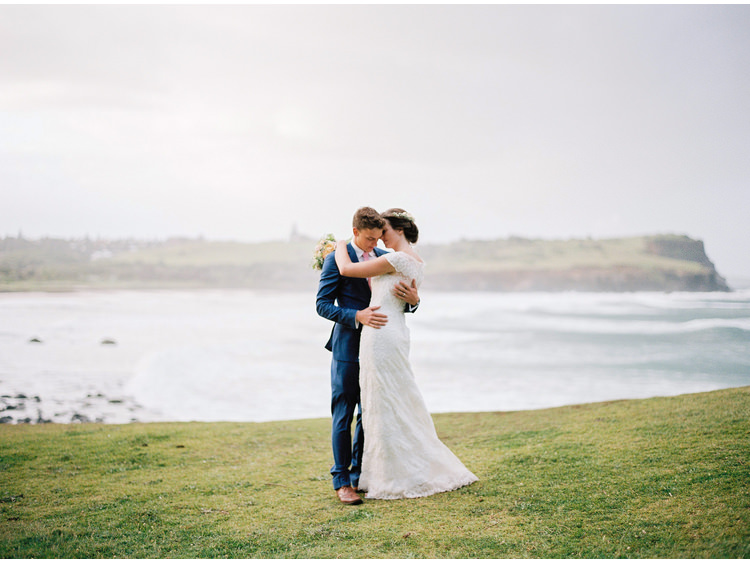 beach-sea-bridal-portrait-bride-byron-bay-nsw-coastal-destination-dress-embracing-fine-art-wedding-photographer-groom-headpiece-flower-crown.jpg