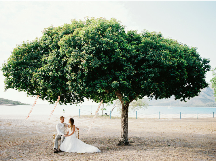 beach-sea-bridal-portrait-bride-coastal-destination-dress-fine-art-wedding-photographer-great-barrier-reef-groom-tree-whitsundays.jpg