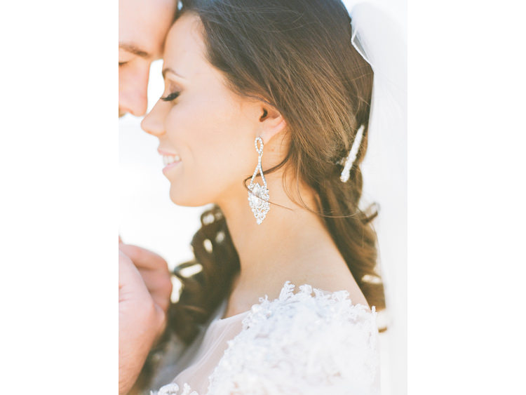 beach-sea-bridal-portrait-bride-Couple-dress-earring-film-photography-fine-art-wedding-photographer-groom-island-kodak-medium-format-portra-stradbroke-straddy-touching-heads.jpg