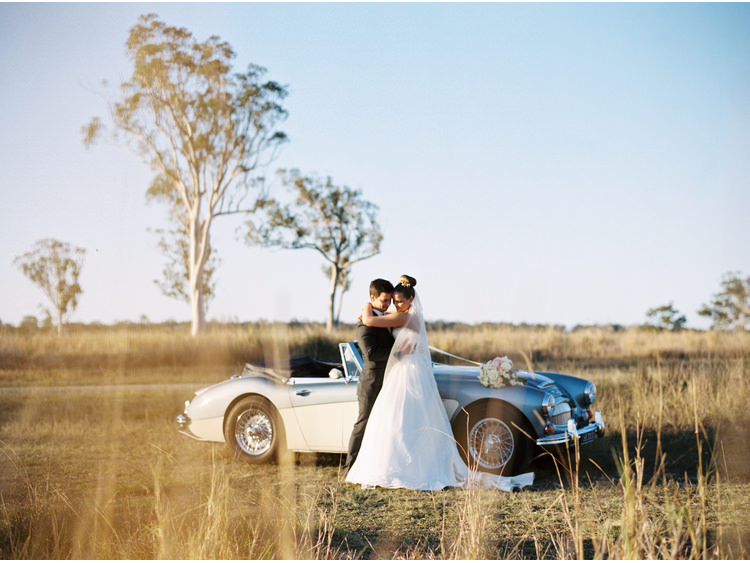 bouquet-flowers-bridal-portrait-bride-brisbane-weddings-car-convertable-dress-fine-art-wedding-photographer-grass-groom-sirromet-winery.jpg