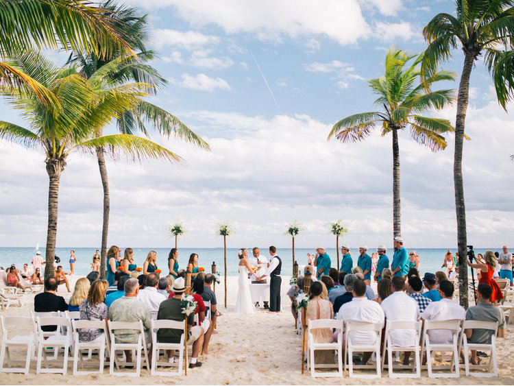 beach-bride-Ceremony-clouds-groom-mexico-palm-playa-del-carmen-sea-trees-Wedding.jpg