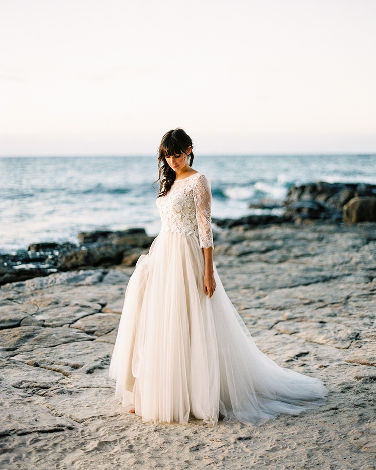 Beautiful Fine Art Film Wedding Photography International Coastal Brunette Nautical Sea with rocks sand lac wedding dress sunset