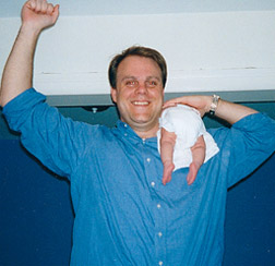 Dave Kirchhoff (and tiny, tiny, tiny daughter Harley) in c1998:  weighing in at an intimidating 245 pounds