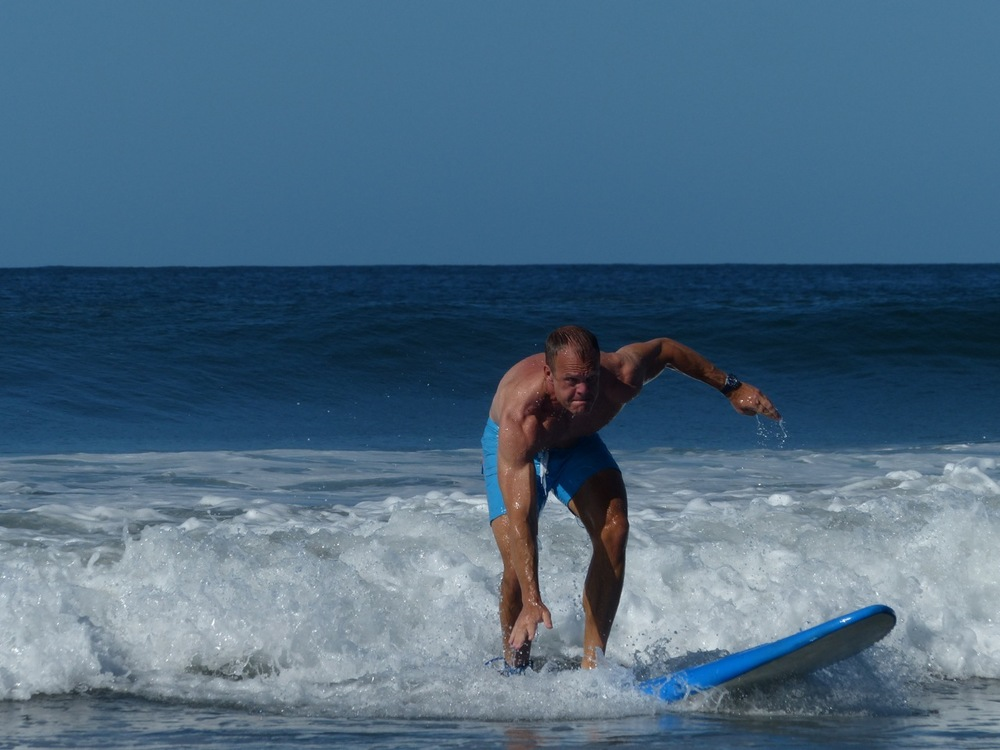 I would like to point out that however poorly I'm doing it, technically I'm standing on the board.  Which makes me officially a surfer.  That being said, I think I now know how I got my fraternity pledge name.  Think Adam's Family.  You rang?