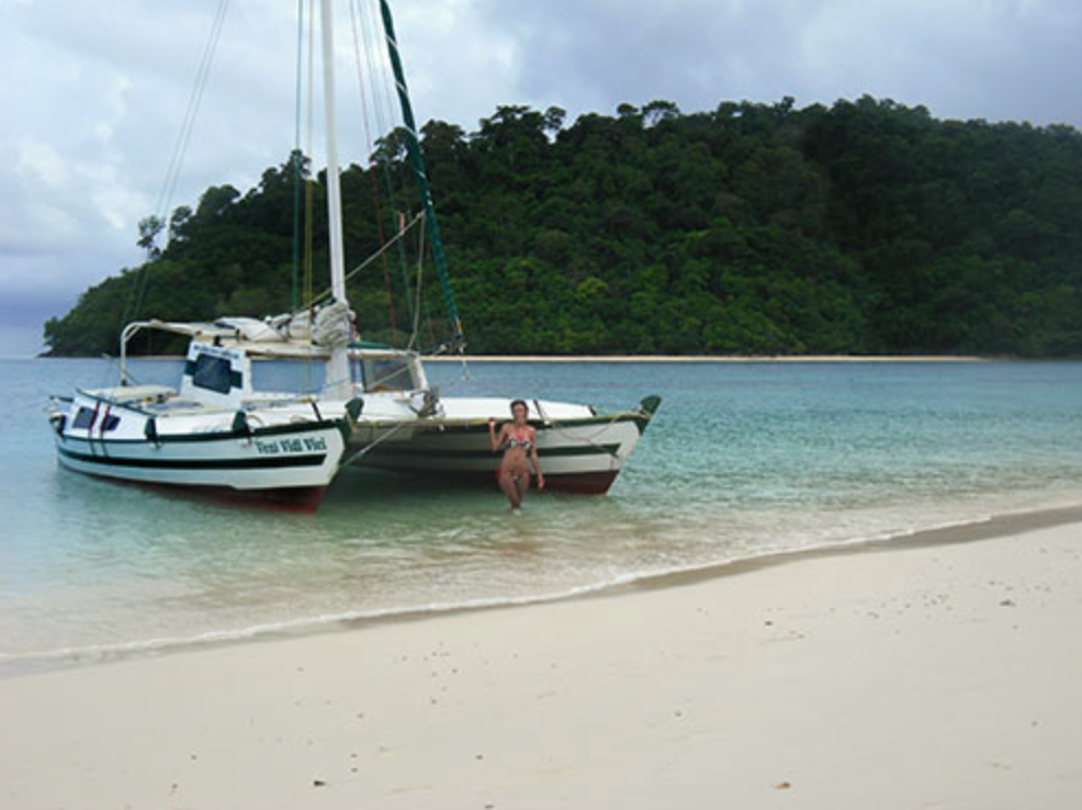 OTBT Tiki 38 Anchored on the beach