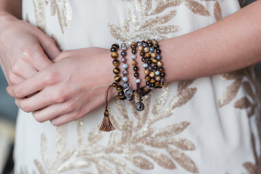 Featuring the  Wood Adjustable Wrap Mala ,  Botswana Agate Om Charm Bracelet  +  Tiger's Eye Mini Tassel Bracelet .