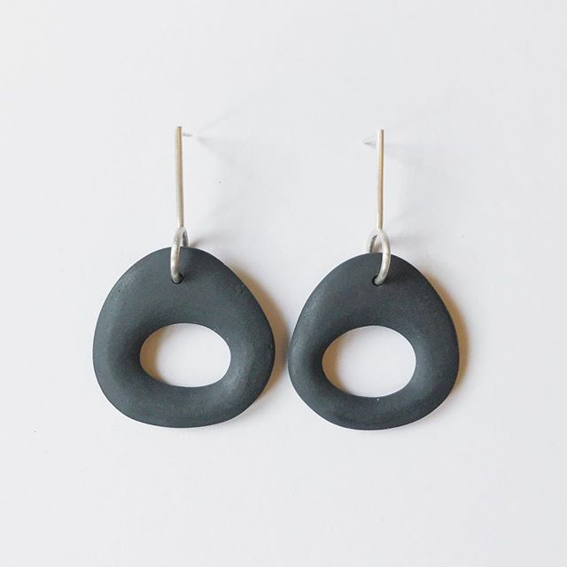 "Just chillin'... Cool to the touch like stone, porcelain is perfect for summer. I am having so much fun re-designing the ""Bone"" series earrings and I can't help myself from taking them for a test run. . . . #yashabutler #minimal #minimalstyle #slowfashion #porcelainjewelry #blackporcelain"