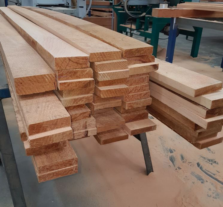 sawn timber about to go through moulding machine tagged image.jpg