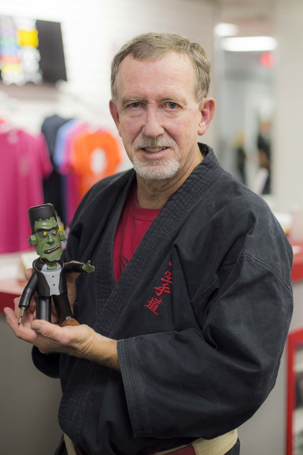 Kyoshi Cunningham showing off a metal figure of Frankenstein that he created and shaped.