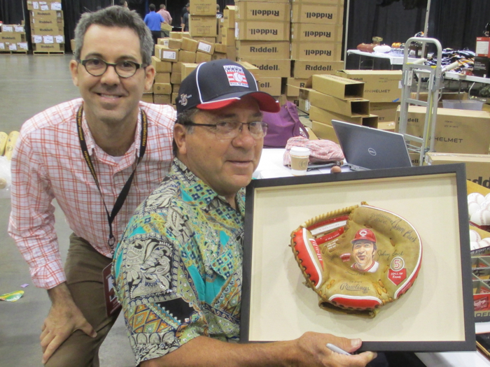 Johnny Bench signs Painted Glove featuring his Hall of Fame career.