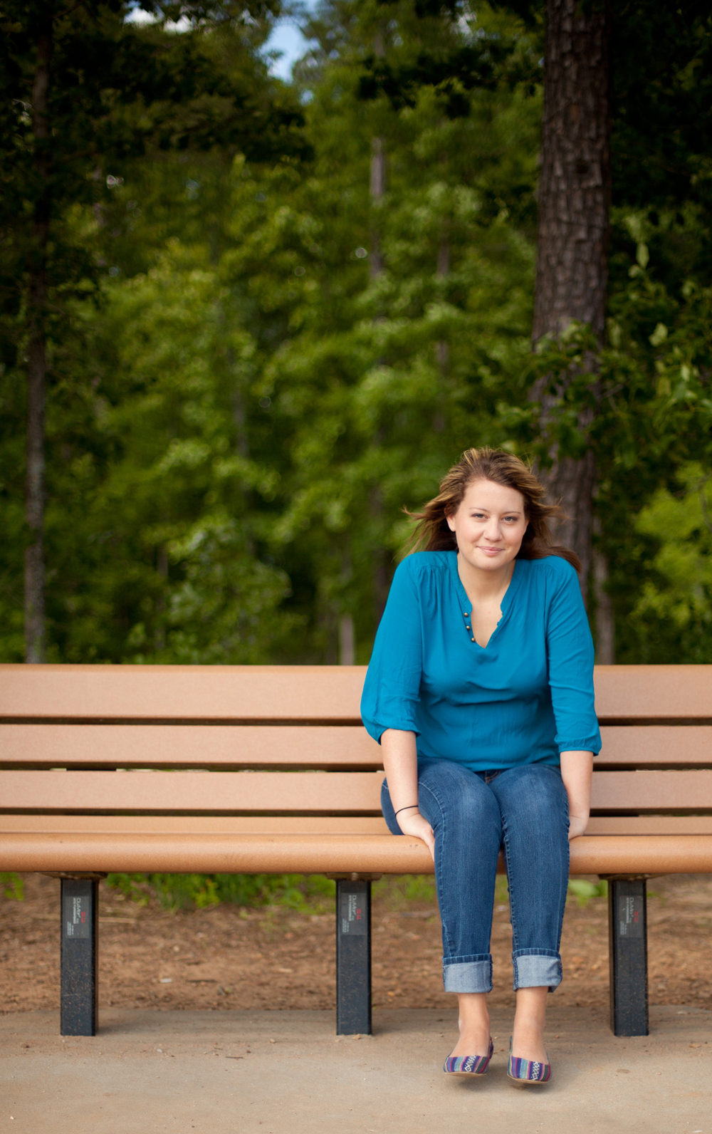 A Girl Sitting on a Bench at Bond Park