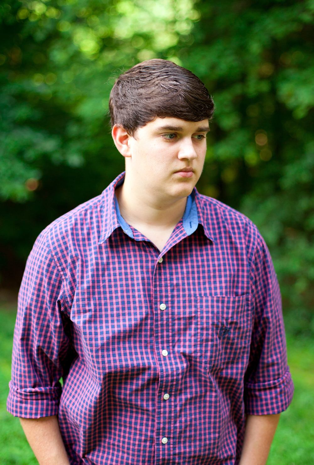 A Handsome Guy Posing for Senior Portraits in NC