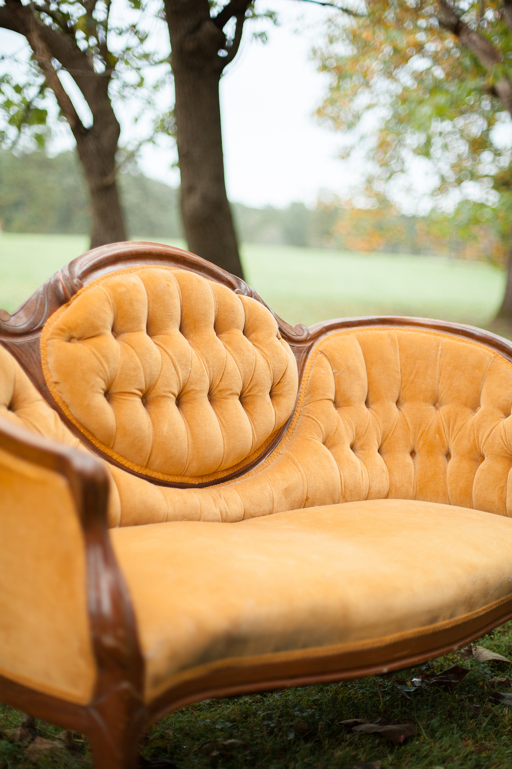 A Yellow Vintage Couch Rental in Durham, North Carolina