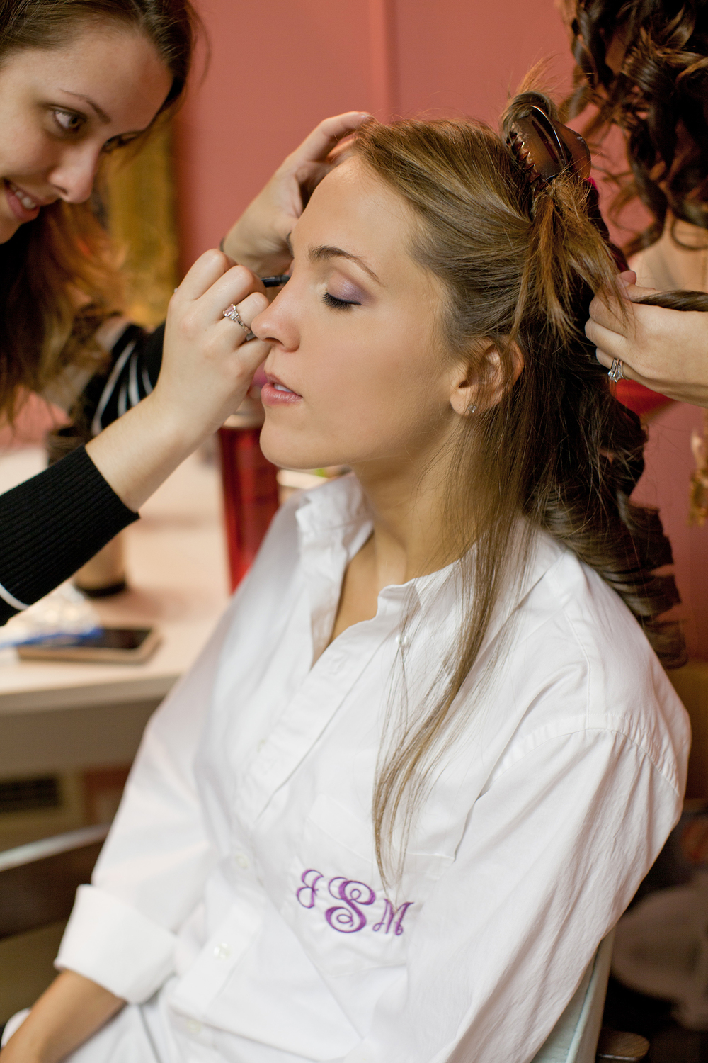 A Bride Having her Makeup Done for her Wedding in Raleigh