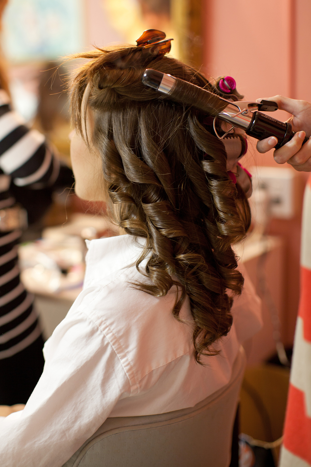 A Bride Having her Hair Done for her Raleigh Wedding