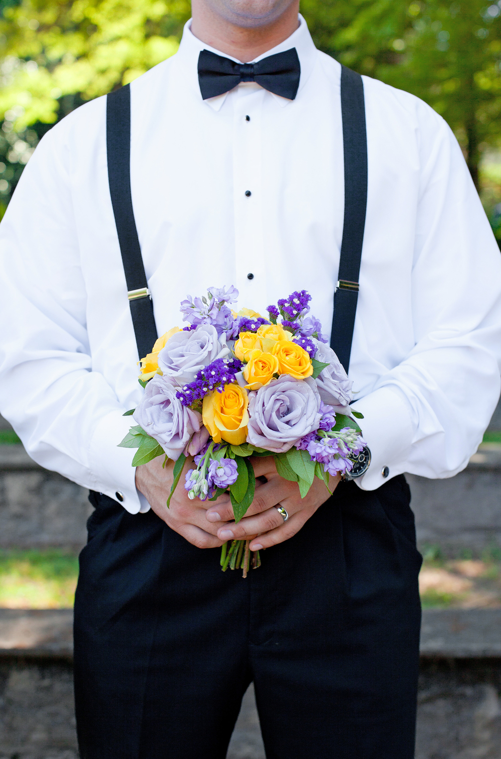 A Groom Holding a Purple & Yellow Bouquet