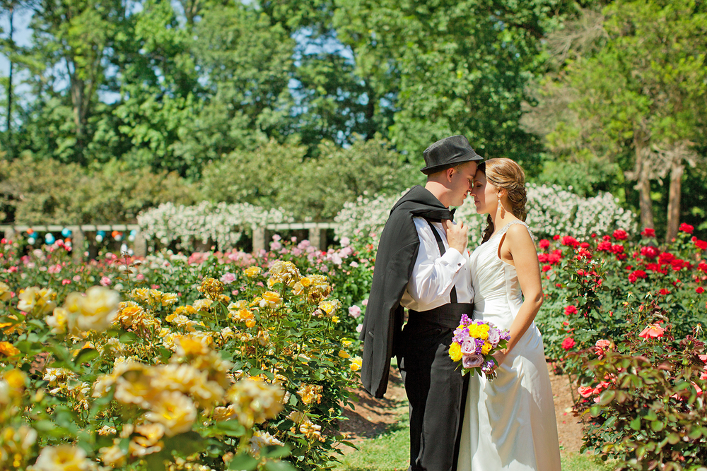A Bride & Groom Posing for Pictures at the Rose Garden