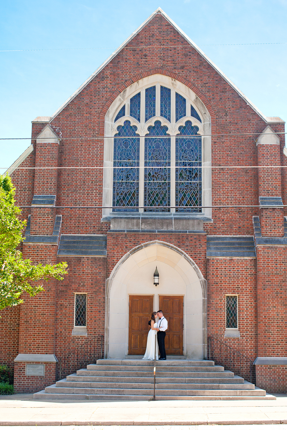 A Bride & Groom in front of Fairmont United Methodist Church