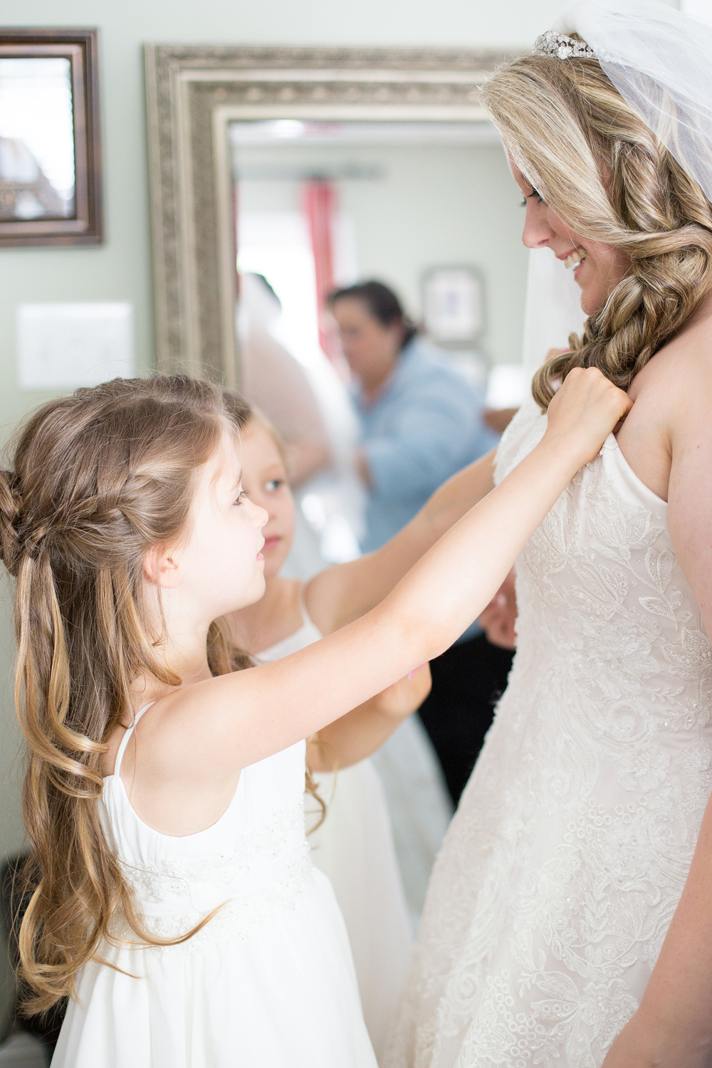Daughters Helping their Mom Get Ready for her Wedding