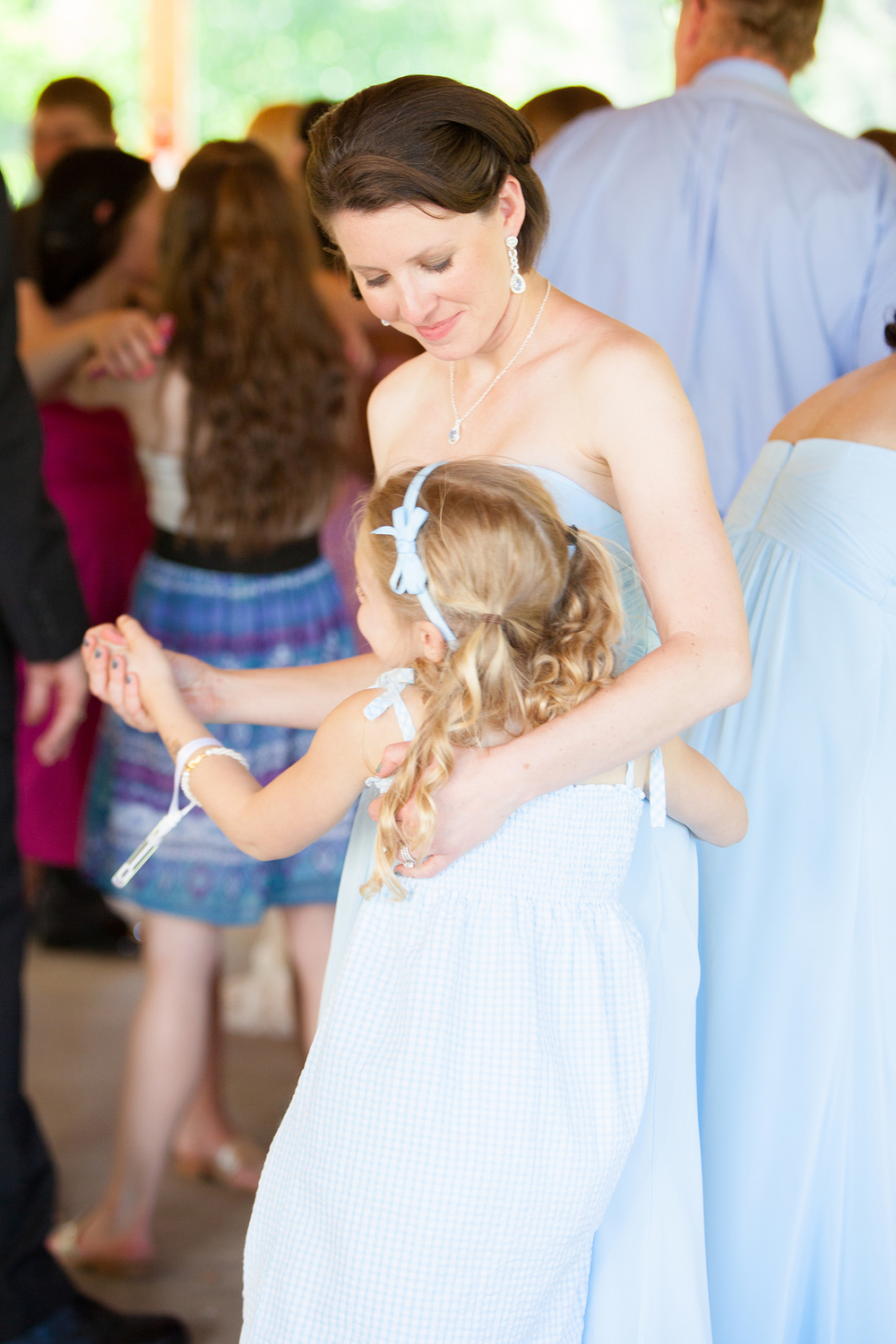 Girl Dancing with Mom at a Wedding