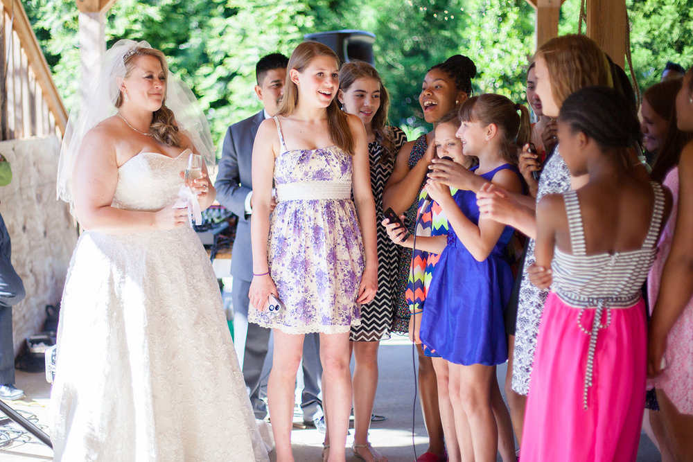 Gymnasts Giving a Speech at their Instructor's Wedding