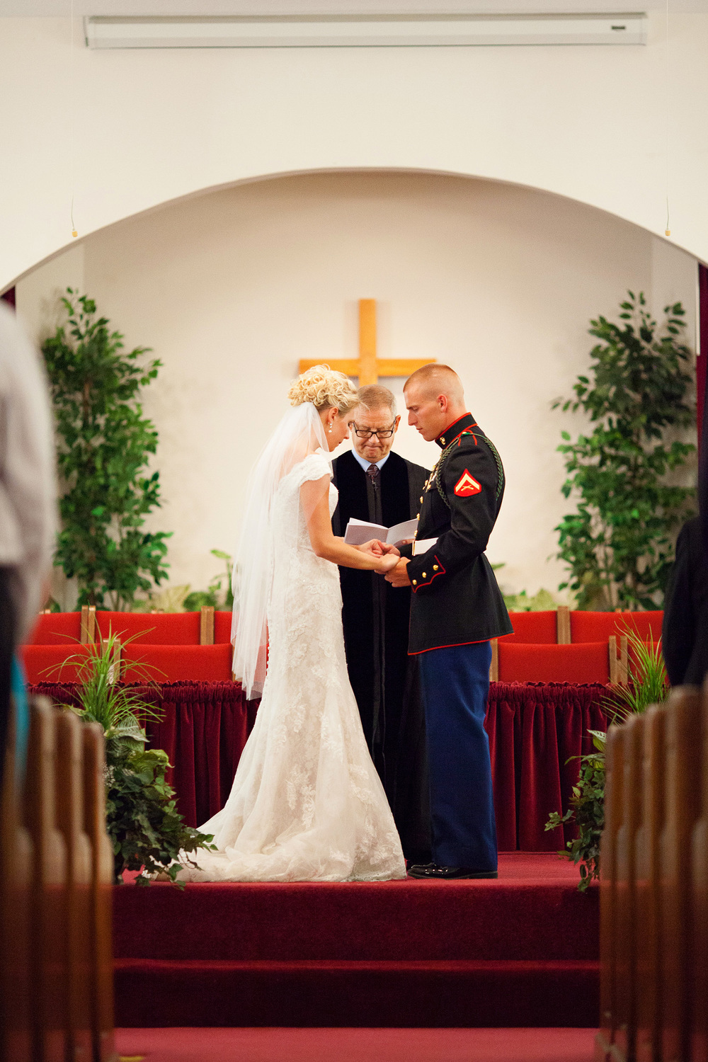 Bride & Groom Praying at their Wedding