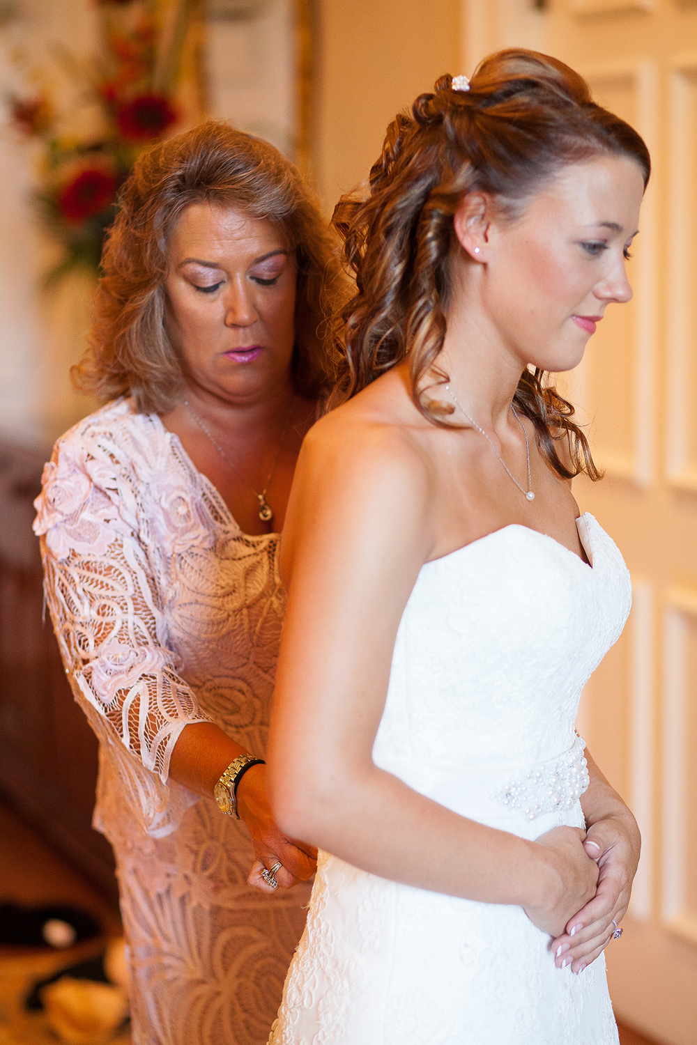 Mother Helping Bride into her Gown