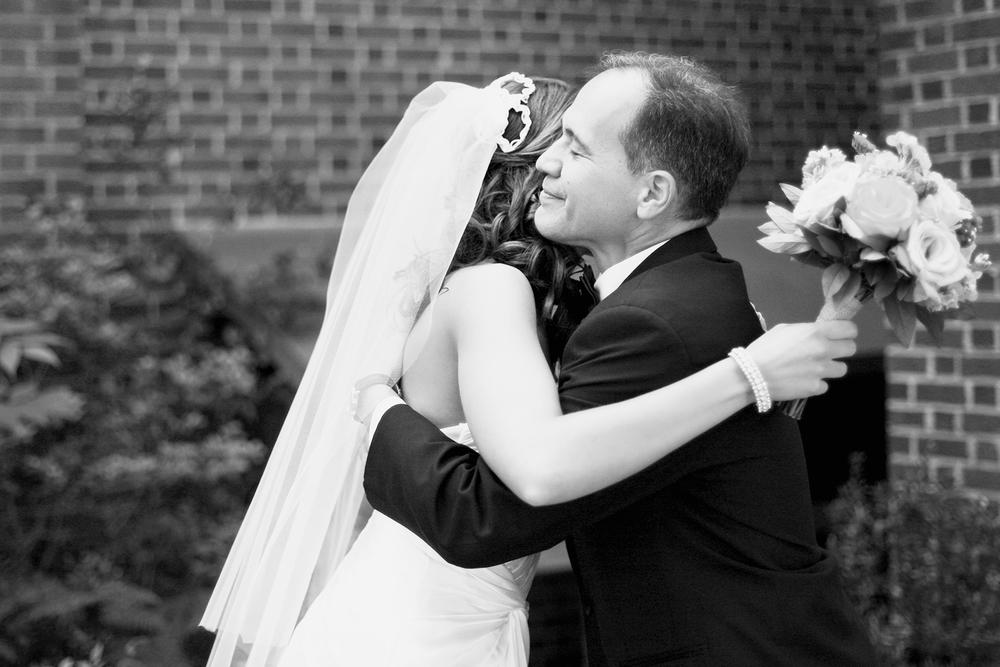 A Father Hugging his Daughter before her Wedding