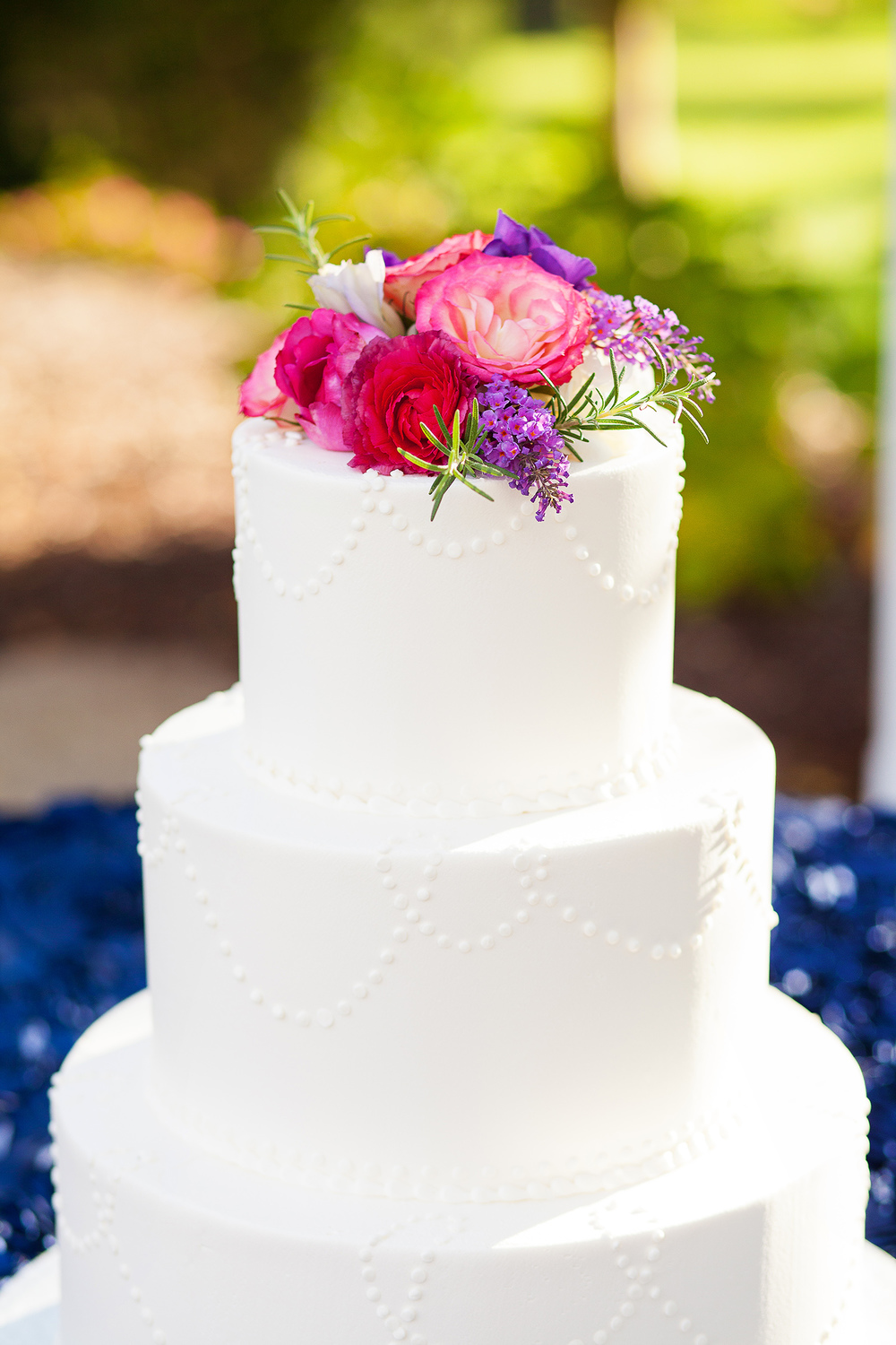 White Wedding Cake with Colorful Florals